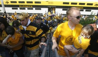FILE - In this file photo from Sept. 5, 2009, fans disembark from the Hawkeye Express train before Iowa's NCAA college football game at Kinnick Stadium in Iowa City, Iowa. The university fired an athletics department accountant on Nov. 6, 2013, for failing to follow the school's cash handling procedures and unsatisfactory job performance, spokesman Tom Moore told The Associated Press, Wednesday, Jan. 29, 2014. (AP Photo/Iowa City Press-Citizen, Matthew Holst, File) NO SALES.