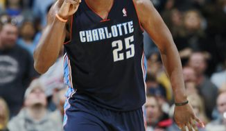 Charlotte Bobcats center Al Jefferson reacts after hitting key shot to put the Bobcats ahead of the Denver Nuggets late in the fourth quarter of the Bobcats' 101-98 victory in an NBA basketball game in Denver on Wednesday, Jan. 29, 2014. (AP Photo/David Zalubowski)