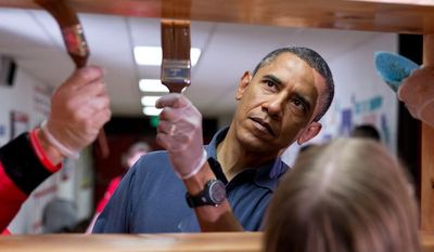 ** FILE ** President Barack Obama helps stain shelves during a National Day of Service school improvement project at Burrville Elementary School in Washington, D.C., Saturday, Jan. 19, 2013. (Official White House Photo by Pete Souza)
