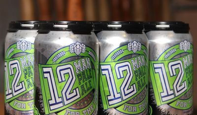 This Jan. 28, 2014 photo shows Dick's Brewing in Centralia,Wash 12 Man Pale Ale.  As the Seattle Seahawks prepare for Super Bowl XLVIII, the Centralia-based microbrewery is scoring big with a beer made just for fans. Dick's Brewing Co. officially released 12 Man Pale Ale in December. Packaged in 12-ounce cans, the beer has quickly become a top seller. The brewery has shipped more than 6,000 cans and 300 kegs so far in January. (AP Photo/The Olympian, Steve Bloom)