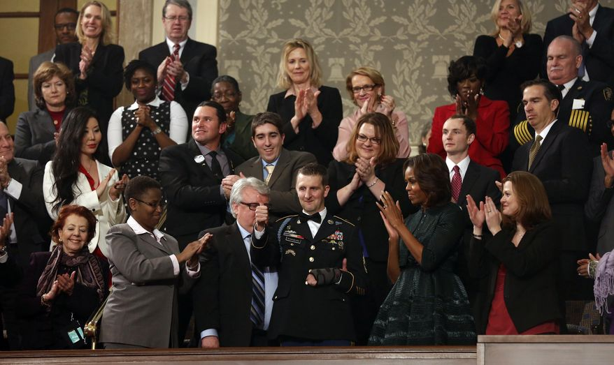 Army Ranger Sgt. 1st Class Cory Remsburg, injured while serving in Afghanistan, gives thumbs up during standing ovation for him after President Barack Obama recognized him during the State of Union address before a joint session of Congress in the House chamber Tuesday, Jan. 28, 2014, in Washington. (AP Photo/Larry Downing, Pool)