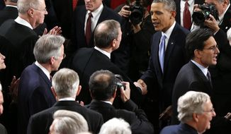 Chief Justice John Roberts greets President Barack Obama before the president gave his State of the Union address on Capitol Hill in Washington, Tuesday Jan. 28, 2014. (AP Photo/Charles Dharapak)