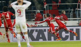 Bayern's Thiago Alcantara of Spain, center, celebrates his side's winning goal during a German first soccer division Bundesliga match between VfB Stuttgart and FC Bayern Munich in Stuttgart, Germany, Wednesday, Jan. 29, 2014. (AP Photo/Michael Probst)