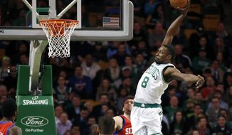 Boston Celtics forward Jeff Green (8) jumps for a dunk during the first half of an NBA basketball game against the Philadelphia 76ers in Boston, Wednesday, Jan. 29, 2014. (AP Photo/Elise Amendola)
