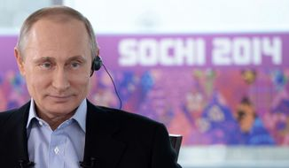 ** FILE ** In this Friday, Jan. 17, 2014, file photo Russian President Vladimir Putin listens to a translation during an interview to Russian and foreign media in the Russian Black Sea resort of Sochi, Russia. (AP Photo/RIA Novosti, Alexei Nikolsky, Presidential Press Service, File)