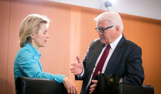 "FILE - In this Jan. 15, 2014 file photo German Minister of Defence Ursula von der Leyen, left, and German Foreign Minister Frank-Walter Steinmeier talk at the beginning of a cabinet meeting at the Federal Chancellery in Berlin, Germany. After years in the diplomatic shadows, Germany looks keen to shed its image as a foreign-policy lightweight and assume a more vigorous role in shaping European policies in global hotspots from central Africa to Syria. New Foreign Minister Steinmeier has declared that Europe ""cannot leave France alone"" in Africa. He and von der Leyen are preparing to reinforce Germany's military role in Mali and help France at least logistically in Central African Republic. (AP Photo/dpa, Kay Nietfeld, File)"
