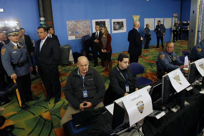 New Jersey Gov. Chris Christie, second left, visits the Super Bowl security operations center Wednesday, Jan. 29, 2014, in East Rutherford, N.J.  (AP Photo/Mel Evans,pool)