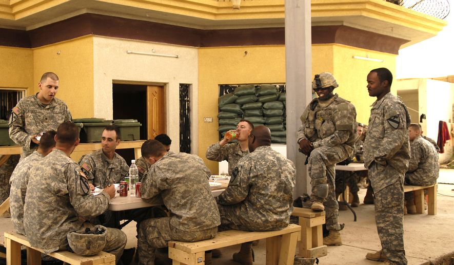 U.S. Army Soldiers from 6th Battalion, 9th Armored Reconnaissance Squadron, 3rd Brigade Combat Team, 1st Cavalry Division eat their one hot meal for the day at a combat outpost in Shakarat, Iraq, April 25, 2007. (U.S. Air Force photo by Staff Sgt. Stacy L. Pearsall) (Released) ** FILE **