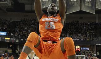 Syracuse's Rakeem Christmas (25) dunks over Wake Forest's Tyler Cavanaugh (34) during the first half of an NCAA college basketball game in Winston-Salem, N.C., Wednesday, Jan. 29, 2014. (AP Photo/Chuck Burton)