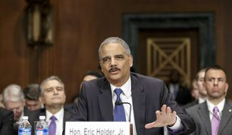 Attorney General Eric Holder testifies on Capitol Hill in Washington, Wednesday, Jan. 29, 2014, before the Senate Judiciary Committee hearing oversight hearing on the Justice Department. (AP Photo/J. Scott Applewhite)