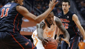 Tennessee forward Jeronne Maymon (34) drives in between Mississipi forward Sebastian Saiz (11) and guard Marshall Henderson (22) during the first half of an NCAA college basketball game Wednesday, Jan. 29, 2014, in Knoxville, Tenn. (AP Photo/Knoxville News Sentinel, Adam Lau)