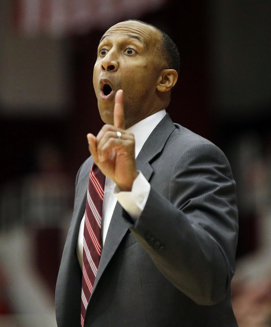 Stanford head coach Johnny Dawkins instructs his team against Arizona during the first half of an NCAA college basketball game on Wednesday, Jan. 29, 2014, in Stanford, Calif. (AP Photo/Marcio Jose Sanchez)