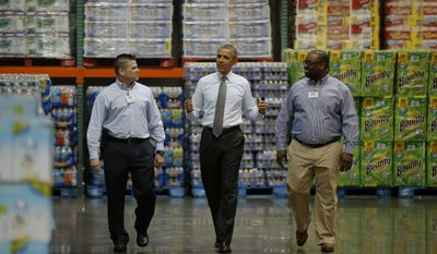 President Barack Obama walks with Ricky Banner, assistant general manager, right, and Emile (Ray) Quevedo, floor employee, at a Costco store in Lanham, Md., Wednesday, Jan. 29, 2014, before he spoke about raising the minimum wage. The president is promoting his newly unveiled plans to boost wages for some workers and help Americans save for retirement _ no action from Congress necessary. (AP Photo/Charles Dharapak)