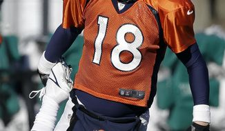 Denver Broncos quarterback Peyton Manning (18) stretches during practice Wednesday, Jan. 29, 2014, in Florham Park, N.J. The Broncos are scheduled to play the Seattle Seahawks in the NFL Super Bowl XLVIII football game Sunday, Feb. 2, in East Rutherford, N.J. (AP Photo/Mark Humphrey)