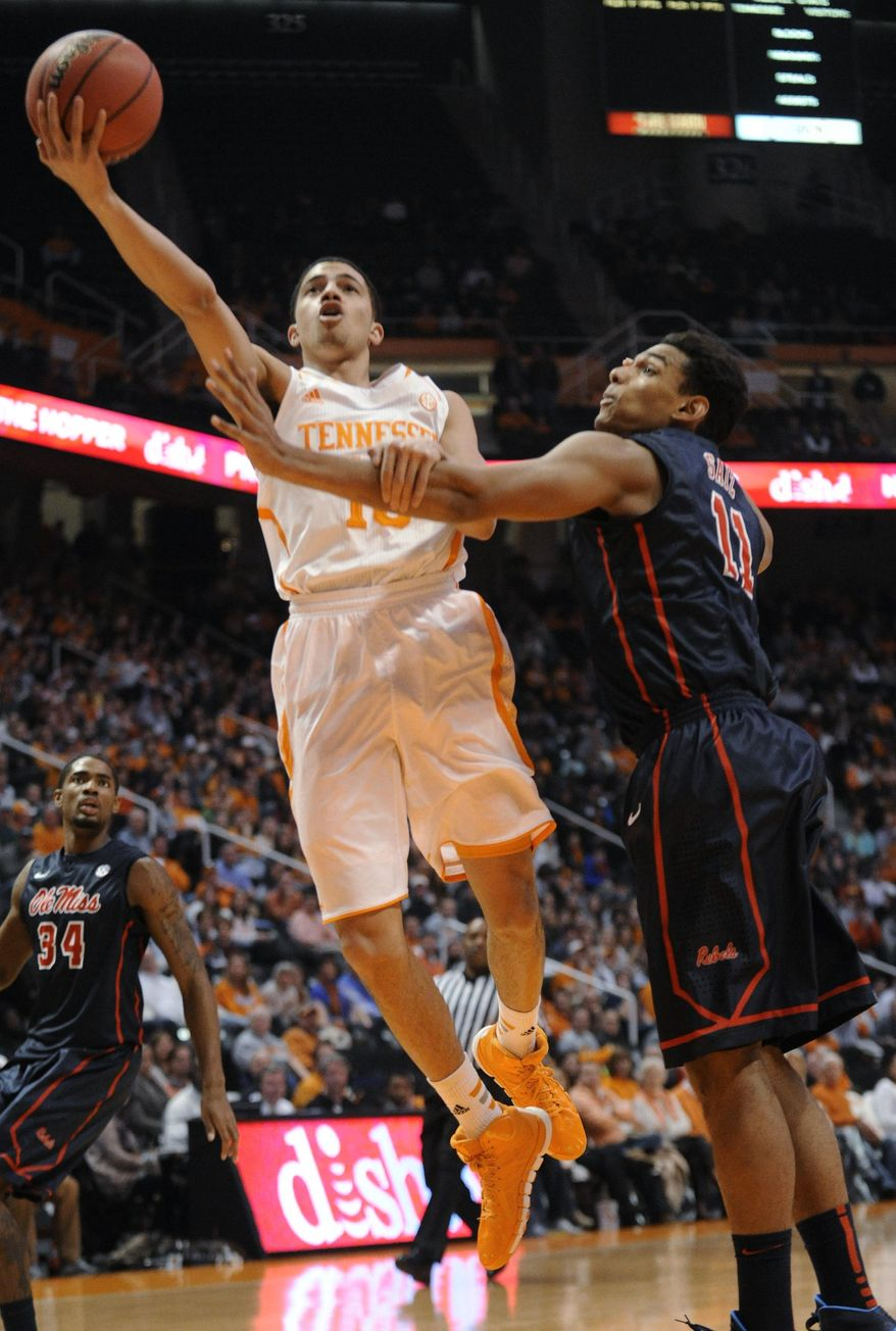 Tennessee guard Darius Thompson (15) shoots a layup past Mississippi forward Sebastian Saiz (11) during the first half of an NCAA college basketball game Wednesday, Jan. 29, 2014, in Knoxville, Tenn. (AP Photo/Knoxville News Sentinel, Adam Lau)