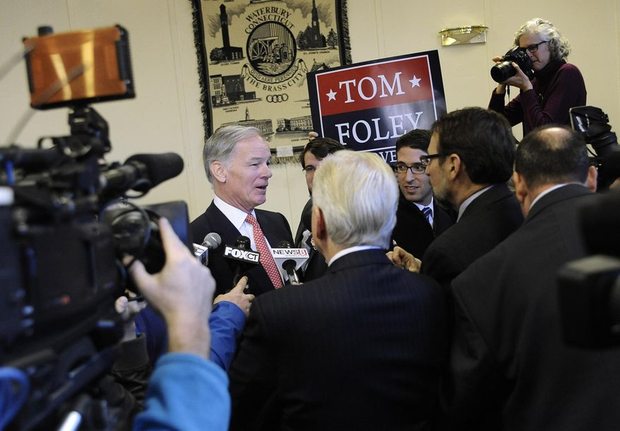 Tom Foley, center, left, speaks to the media during a news conference to announce he is running for governor, Wednesday, Jan. 29, 2014, in Waterbury, Conn. (AP Photo/Jessica Hill)