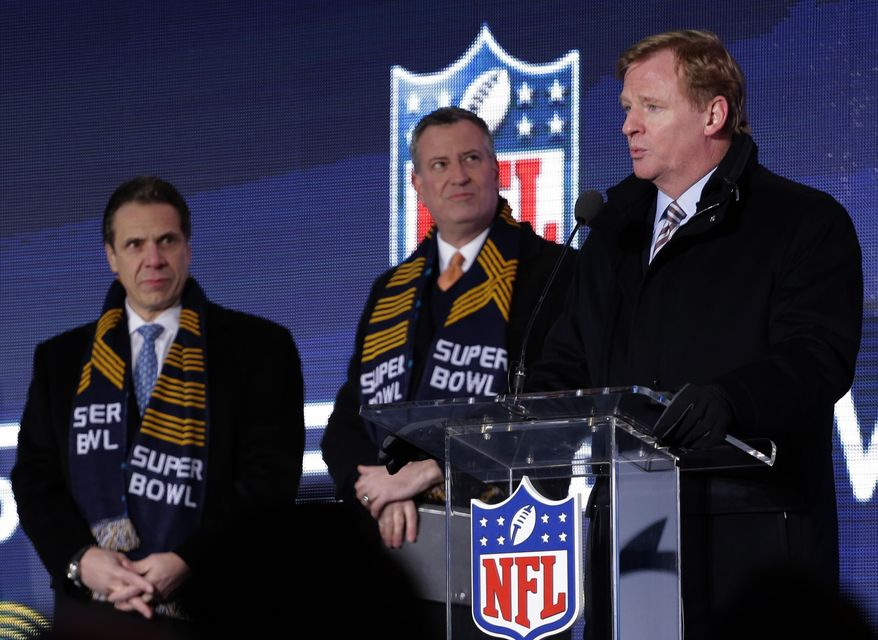NFL comissioner Roger Goodell, right, speaks while New York City Mayor Bill de Blasio, center, and New York Gov. Andrew Cuomo, left, look on during a ceremony unveiling the Roman numerals for Super Bowl XLVIII on Super Bowl Boulevard Wednesday, Jan. 29, 2014, in New York. The Seattle Seahawks are scheduled to play the Denver Broncos in the NFL Super Bowl XLVIII football game on Sunday, Feb. 2, in East Rutherford, N.J.  (AP Photo/Charlie Riedel)