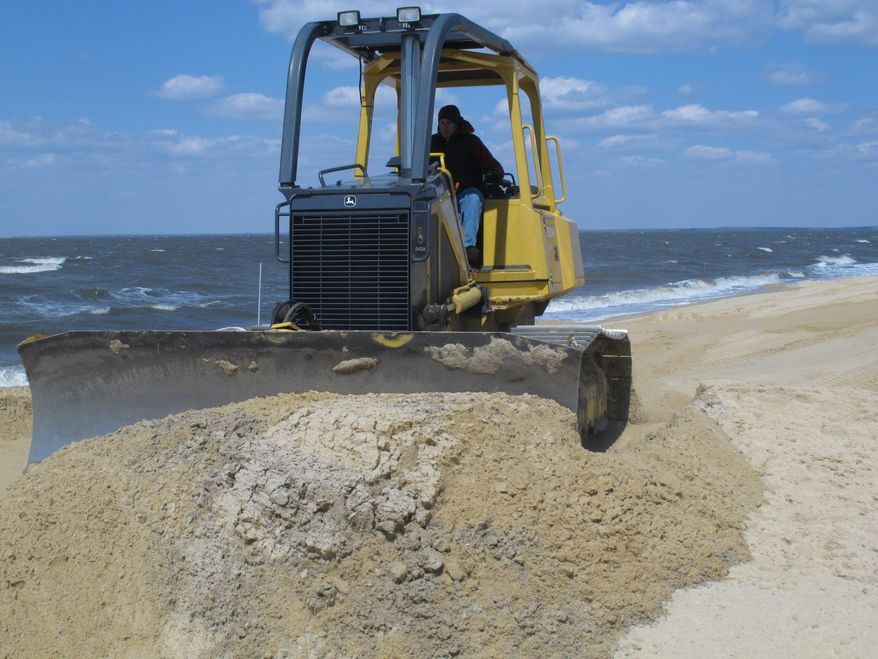 ** FILE ** In this April 2, 2013, photo, a front-end loader moves sand on Delaware Bay Beach in Middle Township, N.J., that was badly eroded by Superstorm Sandy. (AP Photo/Wayne Parry)