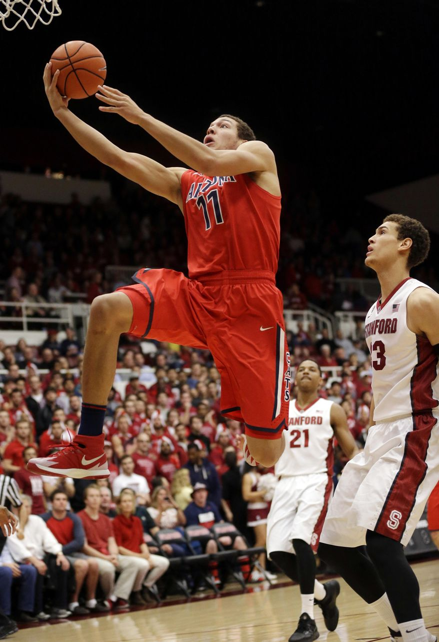 Arizona forward Aaron Gordon (11) drives to the basket past Stanford forward Dwight Powell, right, during the first half of an NCAA college basketball game on Wednesday, Jan. 29, 2014, in Stanford, Calif. (AP Photo/Marcio Jose Sanchez)