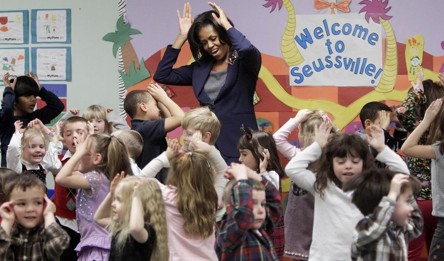 """FILE - In this Friday, March 9, 2012 file photo, first lady Michelle Obama does a bunny hop dance with pre-schoolers at the Penacook Community Center in Concord, N.H., as part of her Let's Move initiative. A new study published in the New England Journal of Medicine on Wednesday, Jan. 29, 2014 finds that much of a child's """"weight fate"""" is set by age 5, and that nearly half of kids who became obese by the eighth grade were already overweight when they started kindergarten. Researchers think there may be a window of opportunity to prevent it, and """"we keep pushing our critical window earlier and earlier on,"""" said Solveig Cunningham, a scientist at Emory University. (AP Photo/Jim Cole)"""