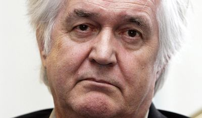 """FILE - In this Tuesday, April 11, 2006 file photo, Swedish crime writer Henning Mankell gestures during a photocall in Hamburg, northern Germany. Mankell wrote on his website Wednesday, Jan. 29, 2014 that he received """"a serious diagnosis of cancer"""" after going to a hospital to check out a hernia in the neck. Mankell is best known for his mystery novels featuring the gloomy inspector Kurt Wallander. (AP Photo/Fabian Bimmer, File)"""