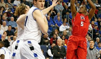 Richmond's Trey Davis (5) shoots during the first half of an NCAA college basketball game against the Saint Louis Wednesday, Jan. 29, 2014, in St. Louis. (AP Photo/Scott Kane)