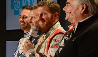 Dale Earnhardt Jr. responds to a question during the NASCAR Sprint Cup Series media tour, while, from left, Jimmie Johnson, Kasey Kahne, Jeff Gordon and team owner Rick Hendrick laugh Tuesday, Jan. 28, 2014, in Charlotte, N.C. (AP Photo/The Charlotte Observer, Jeff Siner) MAGS OUT  TV OUT  ONLINES OUT