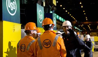 President Barack Obama tours the U.S. Steel Irvin Plant, Wednesday, Jan. 29, 2014, in West Mifflin, Pa., before speaking about retirement policies he highlighted in the State of the Union address. (AP Photo/Carolyn Kaster)