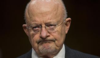 Director of National Intelligence James Clapper listens as he testifies on Capitol Hill in Washington, Wednesday, Jan. 29, 2014, before the Senate Intelligence Committee hearing on current and projected national security threats against the US. (AP Photo/Pablo Martinez Monsivais)