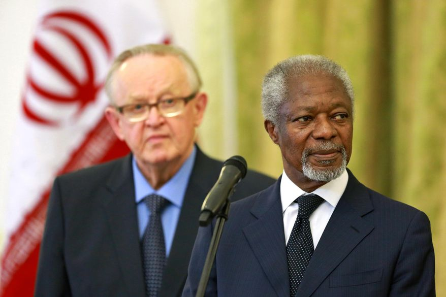 """Kofi Annan, former U.N. secretary general, right, reads a statement at the conclusion of his meeting with Iran's Foreign Minister Mohammad Javad Zarif  in Tehran, Iran, Monday, Jan. 27, 2014, as Martti Ahtisaari, pormer president of Finland, left, listens. The former head of the United Nations urged Iran Monday to build on a historic deal reached with world powers in November and work toward a final settlement over its contested nuclear program. Annan, who is heading a group of ex-world leaders known as """"The Elders,"""" made the comments after a meeting with Iran's Foreign Minister Mohammad Javad Zarif Monday. (AP Photo/Ebrahim Noroozi)"""