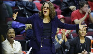 Rutgers coach C. Vivian Stringer reacts to play during the first half of her team's NCAA college basketball game against Louisville on Tuesday, Jan. 28, 2014, in Piscataway, N.J. Louisville won 80-71.(AP Photo/Mel Evans)