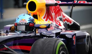 Infiniti Red Bull Racing driver Sebastian Vettel of Germany  drives the new RB10 Formula One car at the Circuito de Jerez on Tuesday, Jan. 28, 2014, in Jerez de la Frontera, Spain. (AP Photo/Miguel Angel Morenatti)