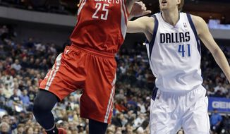 Houston Rockets forward Chandler Parsons (25) drives past Dallas Mavericks forward Dirk Nowitzki (41), of Germany, during the first half of an NBA basketball game Wednesday, Jan. 29, 2014, in Dallas. (AP Photo/LM Otero)