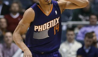 Phoenix Suns' Gerald Green reacts after making a 3-point basket against the Milwaukee Bucks during the second half of an NBA basketball game Wednesday, Jan. 29, 2014, in Milwaukee. (AP Photo/Jeffrey Phelps)