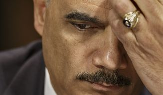 Attorney General Eric Holder pauses while testifying on Capitol Hill in Washington, Wednesday, Jan. 29, 2014, before the Senate Judiciary Committee hearing oversight hearing on the Justice Department. (AP Photo/J. Scott Applewhite)