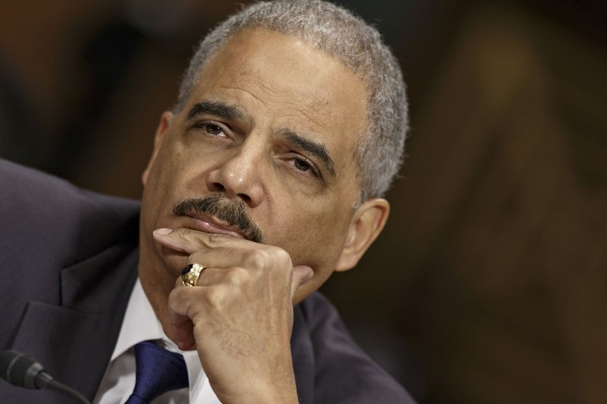 Attorney General Eric Holder listens on Capitol Hill in Washington, Wednesday, Jan. 29, 2104, while testifying before the Senate Judiciary Committee oversight hearing on the Justice Department. (AP Photo/J. Scott Applewhite)