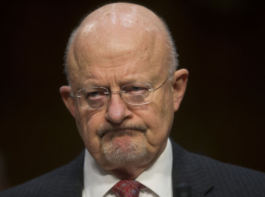 ** FILE ** Director of National Intelligence James Clapper listens as he testifies on Capitol Hill in Washington, Wednesday, Jan. 29, 2014, before the Senate Intelligence Committee hearing on current and projected national security threats against the U.S. (AP Photo/Pablo Martinez Monsivais)