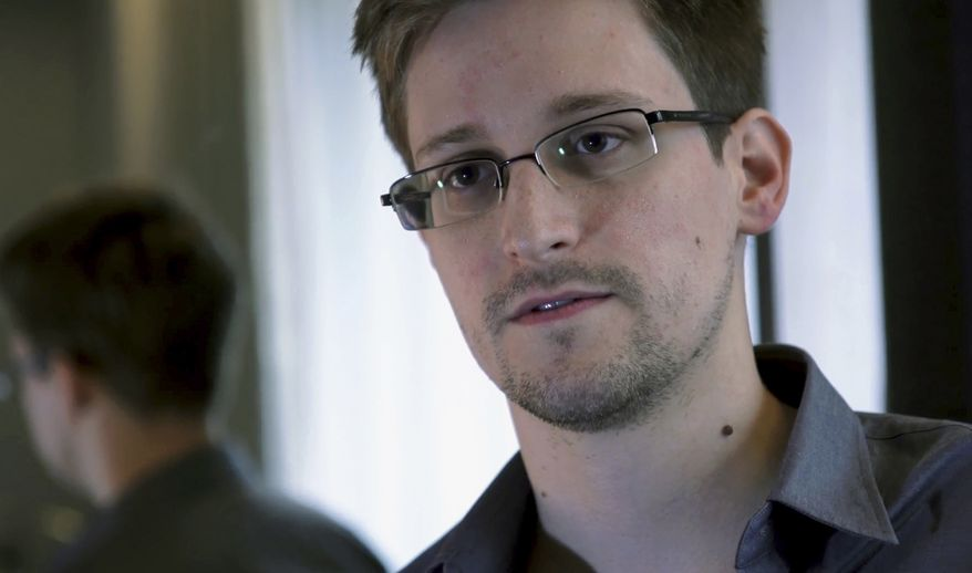 ** FILE ** In this Sunday, June 9, 2013, file photo provided by The Guardian newspaper in London, shows Edward Snowden, who worked as a contract employee at the U.S. National Security Agency, in Hong Kong. Two Norwegian lawmakers said Wednesday, Jan. 29, 2014 that they have jointly nominated former NSA contractor Edward Snowden for the 2014 Nobel Peace Prize. (AP Photo/The Guardian, File)