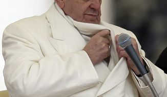 Pope Francis adjusts his scarf during his weekly general audience in St. Peter's Square, at the Vatican, Wednesday, Jan. 29, 2014. (AP Photo/Gregorio Borgia)