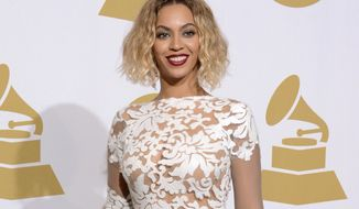 """FILE - This Jan. 26, 2014 file photo shows Beyonce at the 56th annual Grammy Awards in Los Angeles. The Department of Women's and Gender Studies at Rutgers University is offering a course called """"Politicizing Beyonce."""" Kevin Allred, a doctoral student who is teaching the class, tells the university's online news site that he is using her career as a way to explore American race, gender and sexual politics. The class supplements an analysis of her videos and lyrics with readings from Black feminists. (Photo by Dan Steinberg/Invision/AP, FIle)"""