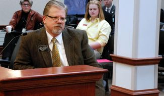 Rep. Steve Hickey, R-Sioux Falls, asks a South Dakota legislative committee on Thursday, Jan. 30, 2014, in Pierre, S.D., to pass a bill that would protect clergy who refuse to take part in gay marriages. The Senate Judiciary Committee defeated the bill.  (AP Photo/Chet Brokaw)