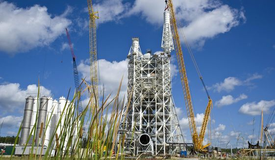 Sky-High costs: The A-3 tower at Stennis Space Center is designed to test how rocket engines operate at altitudes of up to 100,000 feet. Although NASA is compelled to complete the $350 million project, the tower will be mothballed. (NASA)