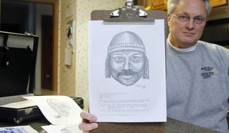FOR RELEASE MONDAY, FEBRUARY 3, 2014, AT 12:01 A.M. CST - In this photo from Jan. 14, 2014, Tim Ewing, a retired sketch artist for the Washington County Sheriff's Department, holds up on of his many composite sketches from 1994 at his home in West Bend, Wis. For nearly 16 of his 27 years at the sheriff's department he created sketches of suspects that lead to arrests. (AP Photo/Rhinelander Daily News, John Ehlke)