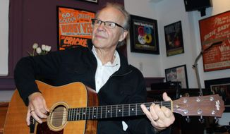"In this photo made Dec. 18, 2013, Bobby Vee playing the guitar at his family's Rockhouse Productions in St. Joseph, Minn. Alzheimer's disease forced the 1960s pop idol to stop performing in 2011 and now 70, Vee is releasing what may be the capstone to his career, ""The Adobe Sessions."" (AP Photo/Jeff Baenen)"