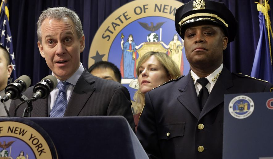 """New York Attorney General Eric Schneiderman, is joined by New York City Police Dept. Chief of Department Philip Banks during a news conference, in New York, Thursday, Jan. 30, 2014.  Police were rounding up 18 people in New York City on Thursday on allegations they sold """"party packs"""" of cocaine and sex to high-end clients and texted their customers to advertise ahead of this week's Super Bowl festivities. (AP Photo)"""
