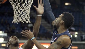 Memphis Grizzlies guard Mike Conley, right, shoots over Sacramento Kings forward Jason Thompson during the first quarter of an NBA basketball game in Sacramento, Calif., Wednesday, Jan. 29, 2014.(AP Photo/Rich Pedroncelli)