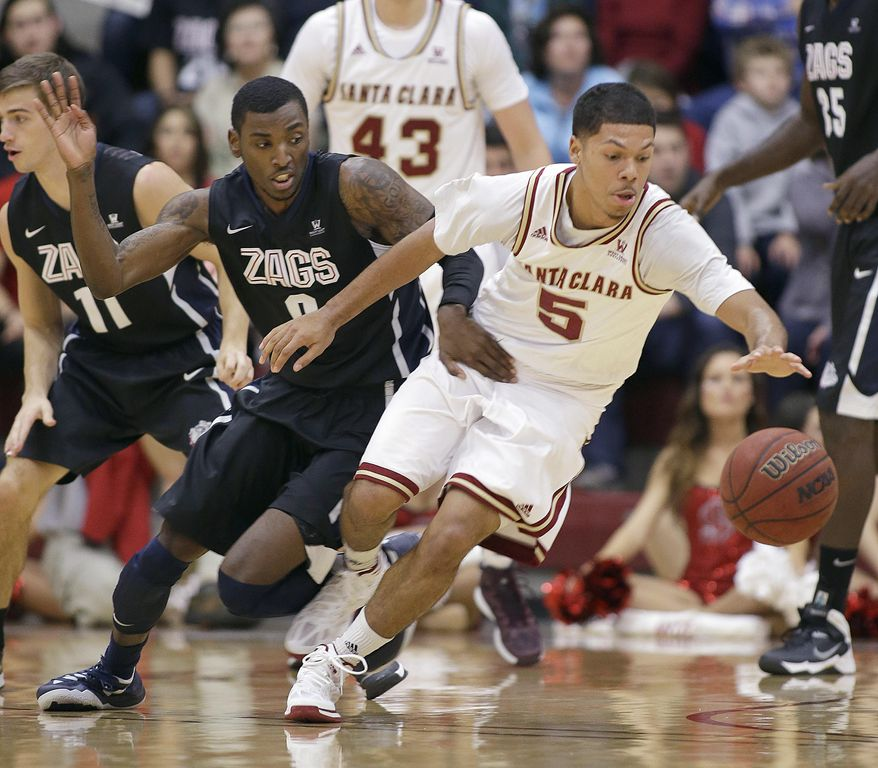 Santa Clara guard Jalen Richard (5) and Gonzaga guard Gerard Coleman (0) chase a loose ball during the first half of an NCAA college basketball game Wednesday, Jan. 29, 2014, in Santa Clara, Calif. (AP Photo/Tony Avelar)
