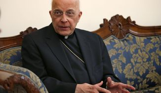 In this Thursday, March 14, 2013 photo, U.S. Cardinal Francis George speaks during an interview at the North American College in Rome. When he turned 75, Cardinal Francis George of Chicago did what the church expects of an archbishop. He submitted his resignation so the pope could decide how much longer the cardinal could serve. But two years and one stunning papal retirement later, the decision now belongs to Pope Francis, in what will be his first major appointment in the United States.  (AP Photo/Michael Sohn)