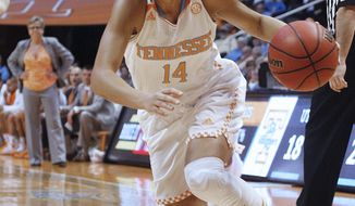 Tennessee guard Andraya Carter drives to the basket while coach Holly Warlick watches the play during the first half of an NCAA college basketball game against Arkansas, Thursday, Jan. 30, 2014, in Knoxville, Tenn. (AP Photo/Lisa Norman-Hudson)