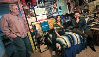 "Ayden Prehara, talks with his parents, Todd and Chris, in his bedroom in Fitchburg, Wis., on Jan. 3, 2014.  Prehara, 16, is a transgender student, having transitioned from female to male at age 14.  This June, Ayden and his parents will travel to Cleveland for what, in the transgender community, is called ""top surgery."" His breasts will be flattened and his chest contoured to be more typically male. He will be 17 by then, about the earliest surgeons will do such surgery. Until then, he wears an undergarment called a binder that evens out his chest. The family is setting aside about $10,000 for the surgery, which includes a week or so in a Cleveland hotel during recovery, said Chris Prehara. Insurance does not cover any of it, she said. (Associated Press/Wisconsin State Journal, John Hart)"